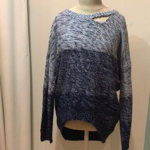 Faded blue sweater